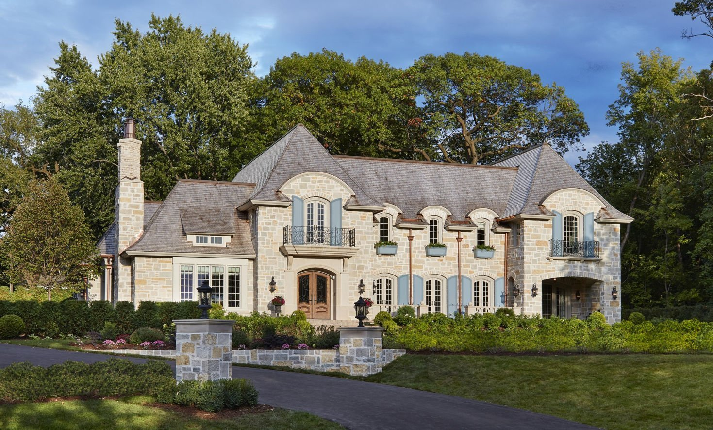 St. Paul French Country home architecture by Charlie & Co. Design